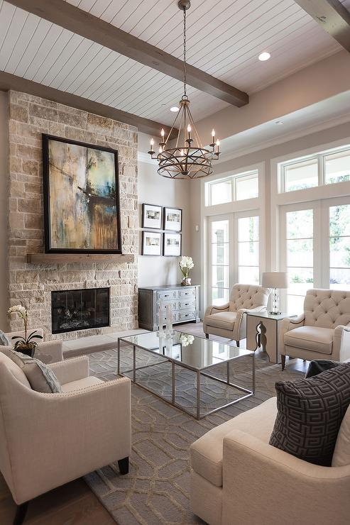 over-the-coffee-table-chandelier-stone-fireplace-rustic-chunky-mantle